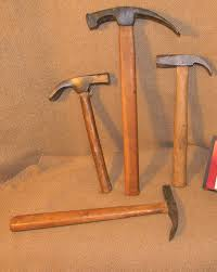 carpenters adze. nailing adze, painted head, g.; 12 oz. tack hammer, vg.; 2 \u2013 carpenters claws sold for 45.00 adze