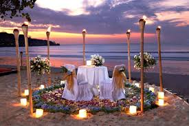 intimate torch lights at a romantic dinner in jimbaran