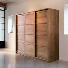 solid wood wardrobe ideas come with sliding door wardrobe and white wall plus granite flooring