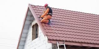 roofer repairing tile shingle roof