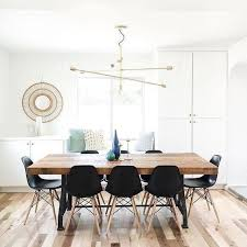 black chairs with a natural wood table mobile chandelier grand 319 ant bronze 55 diam x 33 h adjule arms acmodates six 9w cfl bulbs or 60w