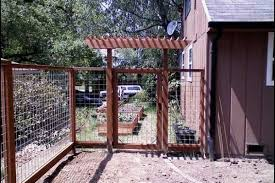 Wire fence with gate arbor Deck Masters llc Portland OR