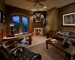 warm home office decor with neutral wall color feat corner fireplace design and oval desk also black shag rug home office