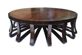 brilliant varnished wood round coffee table design with multiple leg base