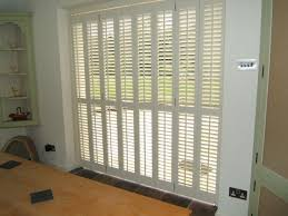 exterior wood shutters plantation for sliding patio doors bypass cost to knock exterior wall install