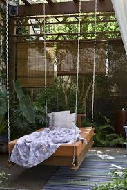 Furniture, Natural Garden Decorating Idea Paired With Swinging Bed With  Blue Striped Rug On Brown