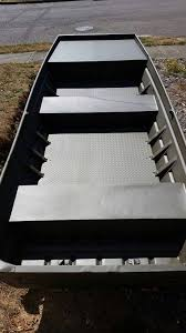 1 16 diamond plate aluminum by the time you mess around with wood sealant and paint you can put in aluminum and never worry about it again