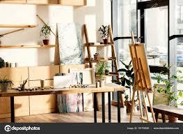 interior artist studio painting supplies laptop table stock photo