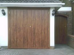 wooden up and over garage door pale green side hinged