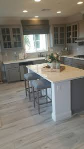 Get this color wood tile floor and paint kitchen cabinets gray