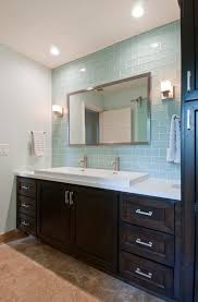 sea glass color bathroom transitional with trough sink wall and floor tiles