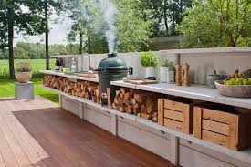 simple outdoor kitchen with smoker and stainless steel sink on wooden deck