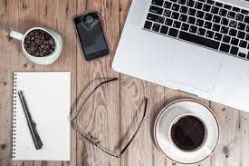 stock photo office working desk top view with laptop notepad glasses smartphone and coffee cup brilliant office table top stock photos images