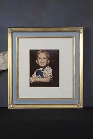 a hand carved frame for a very special portrait