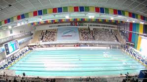 olympic swimming pool 2012. MOSCOW - APR 20: (Timelapse View) Audience Looks Competitions On Swimming In Olympic Pool 2012