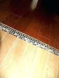 tile to wood transition look mosaic tiles engineered hardwood floor carpet molding l