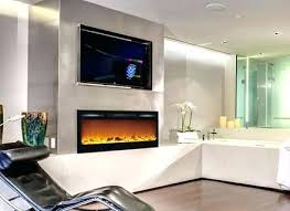 recessed tv above fireplace inch logs recessed wall mounted electric fireplace