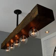 rustic farmhouse style recessed 4 light 5 light dark distressed wood beam large linear island pendant light