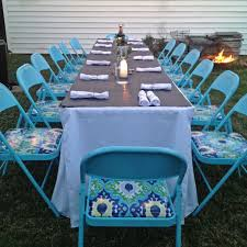 spray painted metal folding chairs with oil cloth seat covering made for a fun
