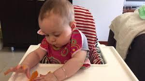 old baby eating ernut squash
