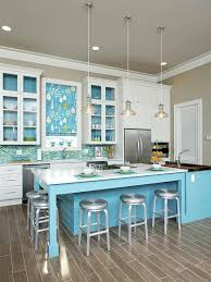really sweet color ideas for kitchen walls.This Alabama beach home is the  perfect place for a colorful kitchen! Blue-green tiles are reminiscent of  tiny ...