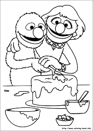 Small Picture Grover and his mom putting icing on a cake Sesame Street