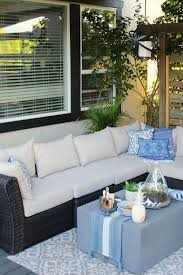 beautiful covered summer patio with outdoor sofa