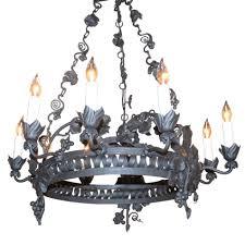 antique italian iron 9 light chandelier decorated in gvine motif