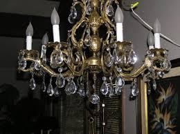 image of antique brass chandelier parts