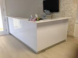 all white reception desk