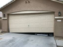 garage doors come off track for a variety of reasons earthquakes normal wear and tear or receiving a hard impact from a car or errant basketball