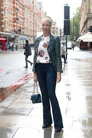 office outfit in bootcut jeans street style jeans and leather jacket
