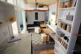 tiny living furniture. genius elevator bed slides vertically on rails to maximize space in alaskan tiny home living furniture t