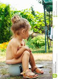 Cute Happy Little Girl Is Sitting On Potty Outdoor Stock