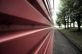 leading lines photography. Architectural Abstract Of A Red Wall With Trees, Leading Lines Photography