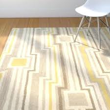 hand tufted beige gray yellow area rug and geometric blue grey