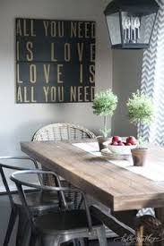 holly mathis interiors sweet cote dining room features iron carriage lantern over salvaged wood dining table