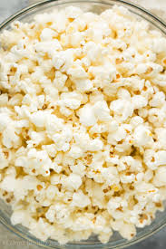 a bowl of healthy homemade air popped popcorn made on the stove
