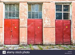 three red doors bearing a danger label Stock Photo: 124511432 - Alamy