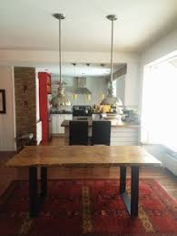 reclaimed wood dining table with 4 wrought iron legs industrial decor