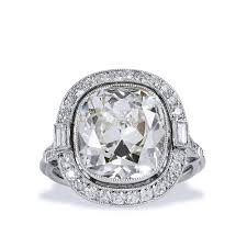 6 53 carat cushion cut diamond ring with baguette and round