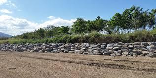 creek ilisation rock seawall contractors queensland rock wall construction