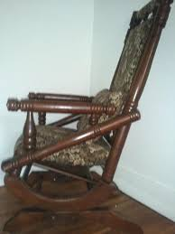 antique wooden rocking chair with actual springs wheels on the front i was wondering what year