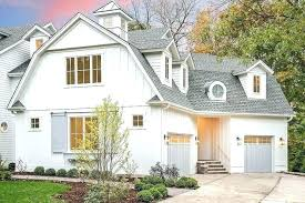 gray house white trim white house grey shutters white cottage style house with separate gray garage doors flanked by carriage white house grey gray house