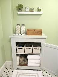 Kids Bathroom Flooring White Wooden Cabinet Having White Wooden Shelves Inside And White