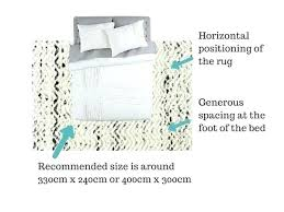 attractive rug under queen bed arts unique and what size bedroom guide catwalk rugs 6x9
