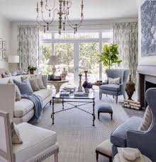 this living room defines the word tranquility light warm gray tones are stacked upon each other in every detail from the rug to the couches to the walls