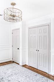 a step by step tutorial for painting interior doors to make a statement in