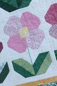 Throwback Thursday: My Second Quilt - Sarah Goer Quilts & ... this one comes from the book Quilting for Dummies. Again, I used my  walking foot to do some straight line quilting, around the petals and  leaves. Adamdwight.com