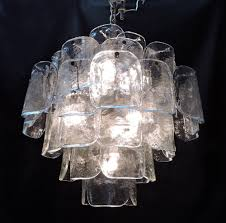 large and unique chandelier made in italy by high quality lighting manufacturer camer this beautiful chandelier has 49 textured and thick clear glass